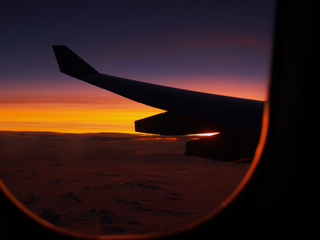 Zonsopgang in vliegtuig