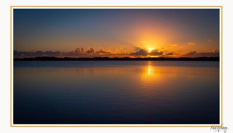 Zonsondergang aan het 1e water