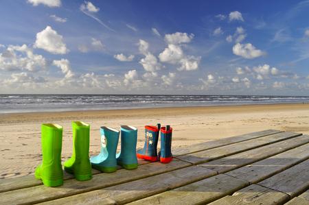 Boots at the beach - In opdracht van .... - foto door mclc op 10-11-2013 - deze foto bevat: zon, strand, sun, laarzen, zand, beach, boots, sand