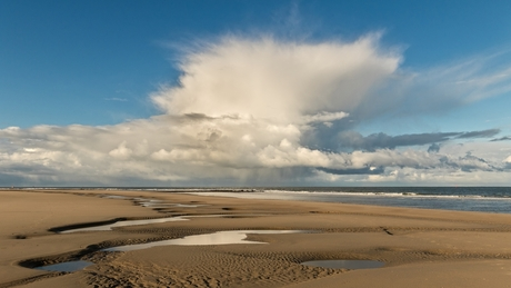 Strand-, zee- en wolkenpracht
