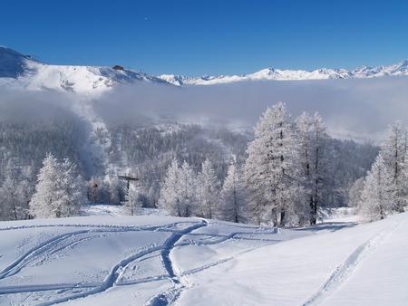 Winter in Sestrière - Winterlandschap in Sestrière (Torino in Italië) - foto door RobertZonnekeyn op 16-01-2020 - deze foto bevat: nature, natuur, sneeuw, winter, vakantie, landschap, bergen, italia, landscape, mountains, alpen, snow, italy, skigebied, alps, frost, torino, Sestriere, winterscape, aanvriezende mist, ski area