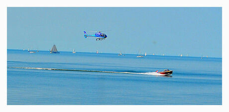 Helicopter follows boat!