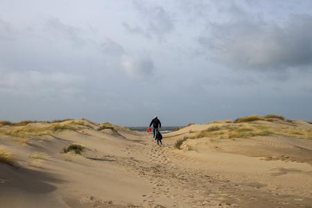 Duinen - Happiness is spending time with your grandfather at the beach and make beautiful memories. - foto door Tannie op 19-02-2020 - deze foto bevat: lucht, strand, zee, natuur, landschap, duinen, storm, zand