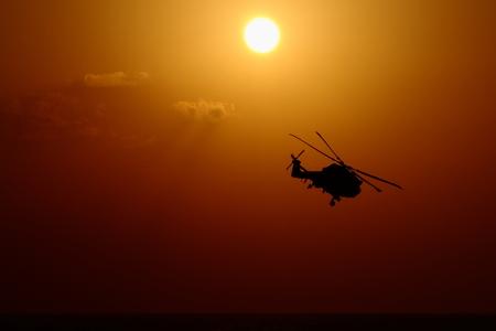 LYNX at sunset - Westland LYNX tijdens zonsondergang - foto door aldowestmaas op 04-04-2012 - deze foto bevat: zonsondergang, helicopter, marine, lynx