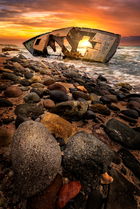 Sunset by the shipwreck