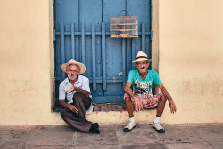 Cubans sitting on the street