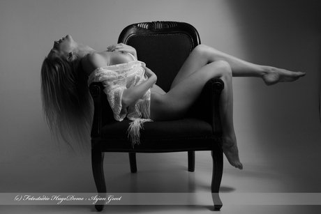 Artnude in a chair