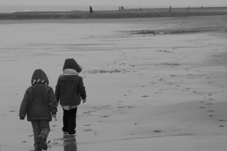 small people on big beach