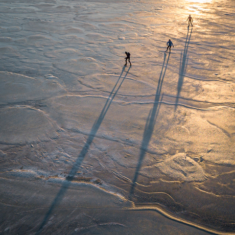 3 ice skaters