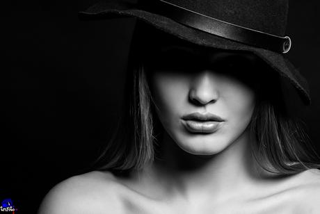 Portret van Neneh met hoed