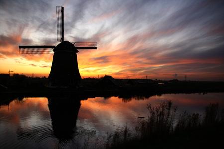 Sky on fire - Waterland, Noord-Holland. - foto door vlienster op 27-03-2011 - deze foto bevat: zonsondergang, reflectie, landschap, molen, holland, nederland, polder, waterlandschap, intense lucht