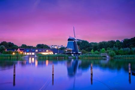 """De Eenhoorn te Haarlem True Colors - I continue my """"windmolen"""" hunting project.  De Eenhoorn te Haarlem has been build in1776. This is a stack of 6 exposures, times (15s-20s) at 80 ISO.  - foto door lcutolo op 06-01-2018 - deze foto bevat: molen, haarlem, light, landscape, reflections, windmill, sony, night, spaarne, outdoor, zeiss, tlp, flickr, Aperture, long exposure, sony alpha, Dutch landscape, ngc, a7ii, onone software, world trekker, silky clouds, night shooter, hdr-like, f4 lens, de eenhoorn te haarlem, blue hours"""
