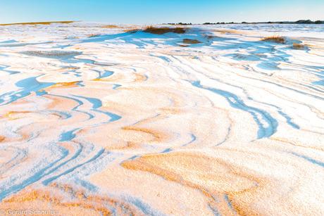 Zand, sneeuw en wind