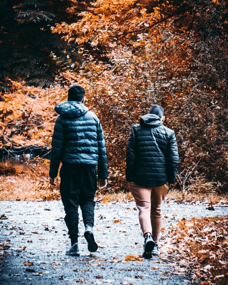 Two boys having an autumn walk