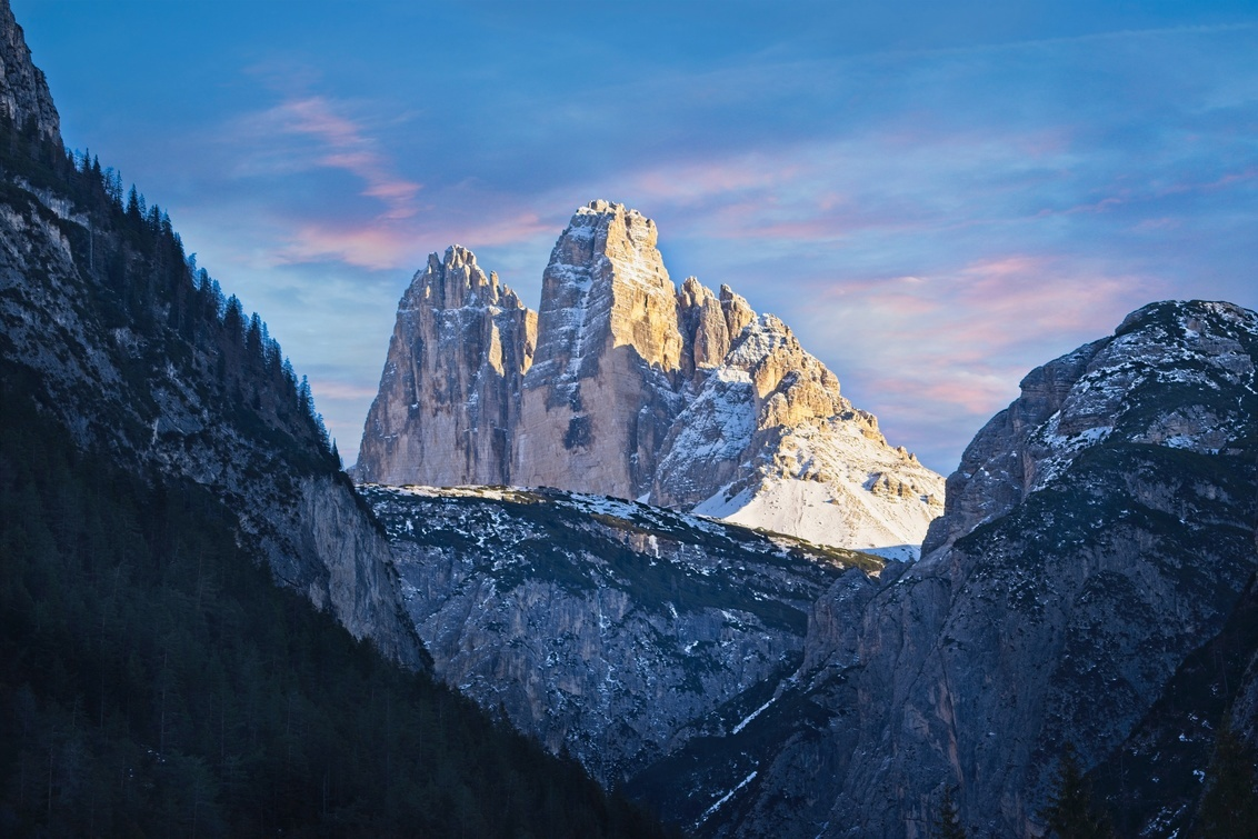2 Cime out of 3 - This winter we went to Val Pusteria, Dolomites. Our hotel location was perfect for some of the most iconic places on the Dolomites. This shot is from - foto door lcutolo op 29-01-2019 - deze foto bevat: pink, winter, sunrise, landscape, mountains, sony, snow, italy, village, alps, saturation, scape, vignette, tlp, flickr, Dolomites, purple sky, ngc, world trekking, world trekker, perfect effect, one software, onone, luca cutolo, golden hours, sony a7iii, south tyrol, onone raw 2019, sun-rise, landro, dolomite aurora, cime di lavaredo, 3 cime
