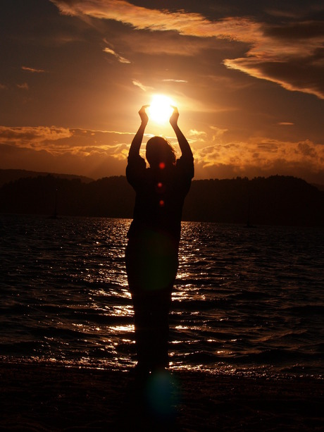 The sun in her hands...