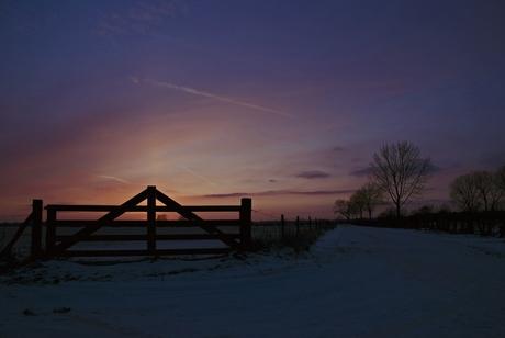 Hek met zonsondergang