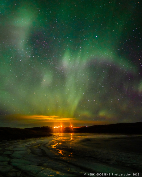 Lady Aurora above the Langá river, outside Borgarnes. Iceland