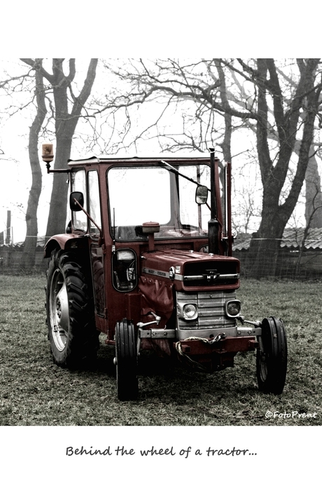 behind the wheel of a tractor