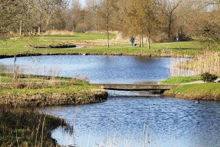 Golfbaan - - - foto door fotohela op 02-03-2021 - deze foto bevat: lucht, wolken, water, panorama, natuur, licht, winter, landschap, bomen, meer, polder, golfbaan, zeegersloot