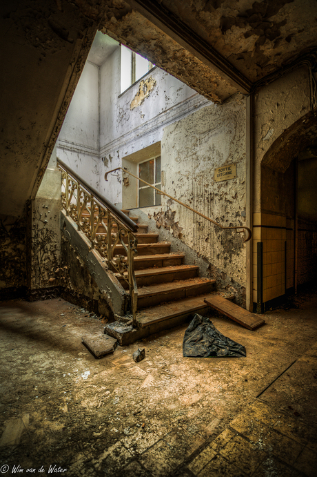 Down stairs to the basement