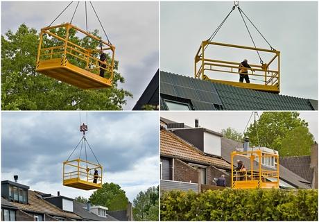 De doe-het-zelf dakdekker zweeft door de lucht.