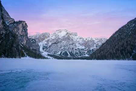 Lago di Braies 1 - This winter we went to  Val Pusteria, Dolomites. Our hotel location was perfect for some of the most iconic place on the Dolomites. Here few shots. T - foto door lcutolo op 15-01-2019 - deze foto bevat: sunset, pink, winter, landscape, lake, mountains, sony, snow, italy, lago, alps, saturation, scape, vignette, tlp, Dolomites, frozen lake, ngc, world trekking, world trekker, perfect effect, one software, onone, luca cutolo, sun-set, purple sunset sky, golden hours, sony a7iii, south tyrol, onone raw 2019, braies
