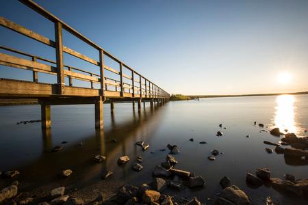 Last night - - - foto door WM-Dual-Photography op 19-07-2016 - deze foto bevat: zon, zonsondergang, reflectie, zomer, natuurgebied, brug, zeeland, nederland, Schouwen-Duiveland