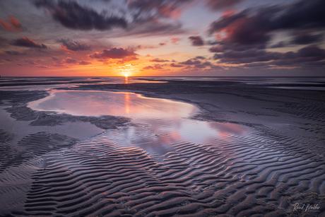 Zonsondergang bij de vuurtoren van Texel