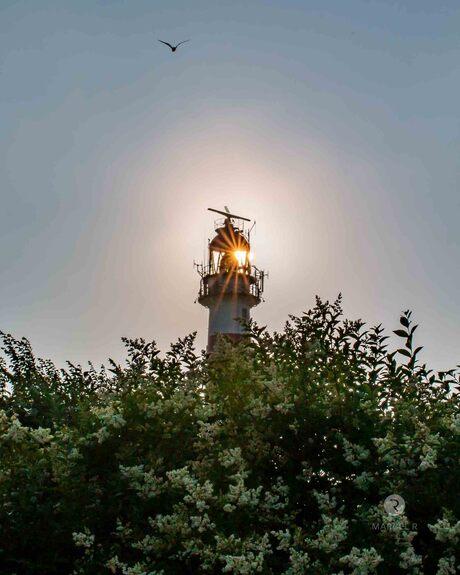 when sun meets lighthouse